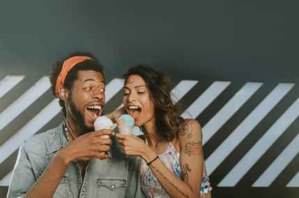 man and woman eating ice creams